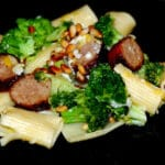 Dinner is Served…Rigatoni, Sweet Italian Sausage, & Broccoli Topped with Toasted Pignoli Nuts, Lemon Zest, & Asiago Cheese