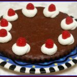 FLOURLESS CHOCOLATE CAKE WITH FRESH WHIPPED CREAM & RASPBERRIES