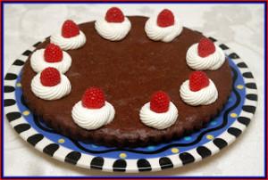 FLOURLESS CHOCOLATE CAKE WITH FRESH WHIPPED CREAM & RASPBERRIES