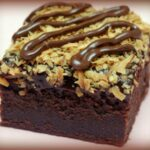MASCARPONE BROWNIES TOPPED WITH CHOCOLATE GANCHE & TOASTED COCONUT