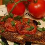 CATFISH BREADED WITH CHIA SEEDS & PAN FRIED IN AVOCADO OIL WITH ROASTED TOMATOES