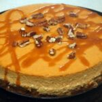 PUMPKIN PIE CHEESECAKE WITH SALTED CARAMEL & PECANS