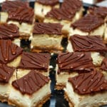 DULCE DE LECHE CHEESECAKE BARS SERVED WITH A MASON JAR FILLED WITH HOMEMADE SALTED CARAMEL