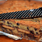 CHOCOLATE CHIP COOKIE BARS STUFFED WITH SALTED CARAMEL AND PEANUT BUTTER CUPS