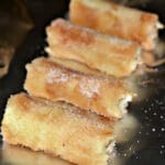 FRENCH TOAST STICKS STUFFED WITH SWEETENED CREAM CHEESE & SERVED WITH MAPLE SYRUP