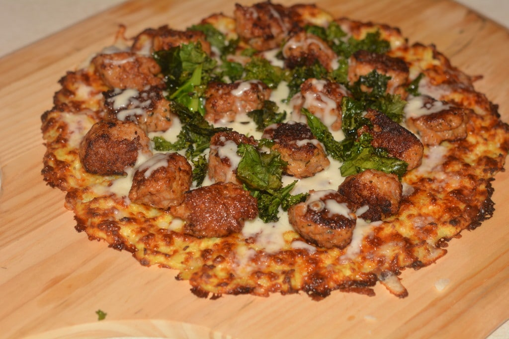 cauliflower pizza with sausge and kale chips