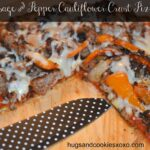 Cauliflower Pizza Crust Topped With Sausage & Peppers